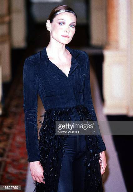 Model Carla Bruni walks the runway during the Chanel Haute Couture Fall/Winter show as part of the Paris Haute Couture week on July 15 1996 in...