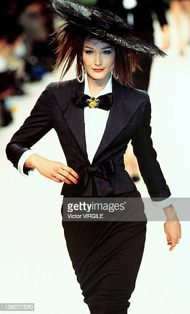 Model Carla Bruni walks the runway during the Chanel Haute Couture Spring/Summer show as part of the Paris Haute Couture week on January 17 1995 in...