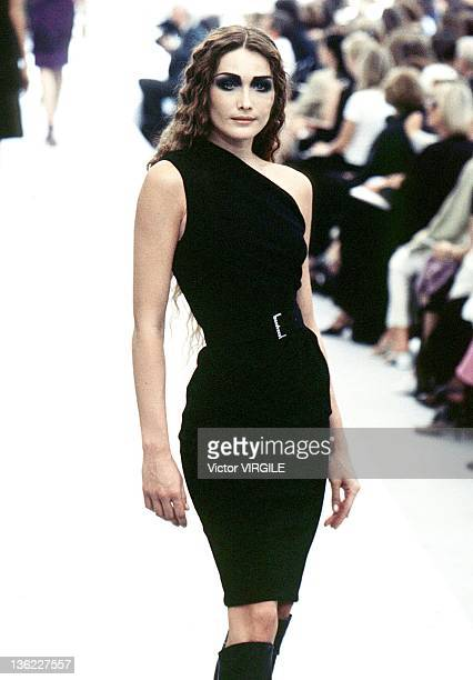 Model Carla Bruni walks the runway during the Chanel Haute Couture Fall/Winter show as part of the Paris Haute Couture week on July 17 1997 in...