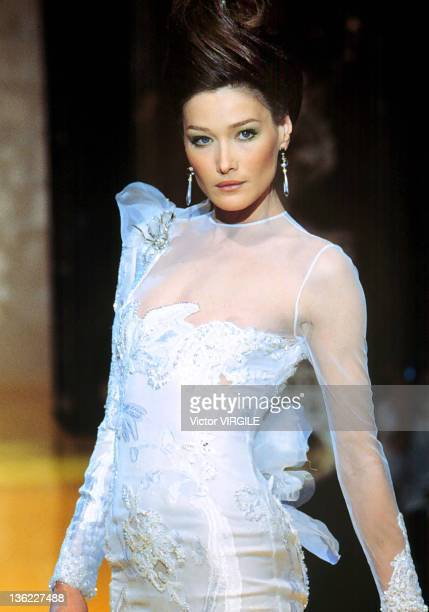 Model Carla Bruni walks the runway during the Dior Haute Couture Spring/Summer show as part of the Paris Haute Couture week on January 14 1995 in...