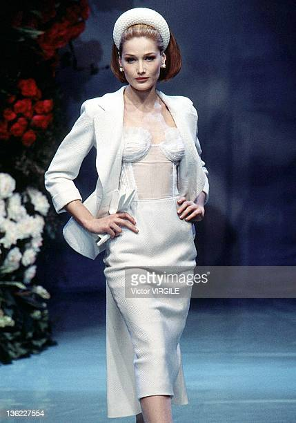Model Carla Bruni walks the runway during the Dior Haute Couture Spring/Summer show as part of the Paris Haute Couture week on January 17 1996 in...