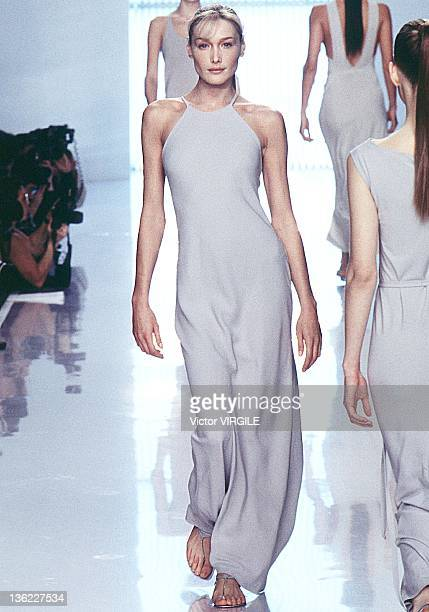 Model Carla Bruni walks the runway during the Donna Karan Ready to Wear Spring/Summer 1996 show as part of the New York Fashion Week on November 11...