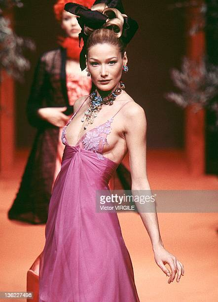 Model Carla Bruni walks the runway during the Lacroix Haute Couture Spring/Summer show as part of the Paris Haute Couture week on January 20 1996 in...
