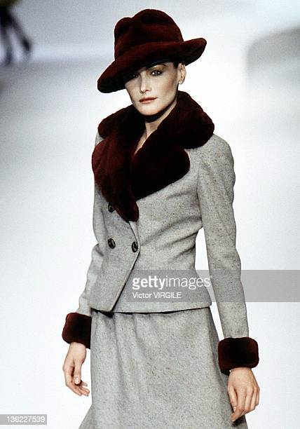 Model Carla Bruni walks the runway during the Valentino Ready to Wear Fall/Winter 1996 1997 show as part of the Milan Fashion Week on March 21 1996...