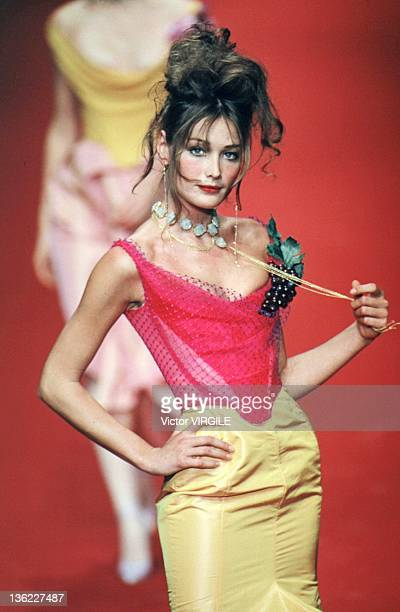 Model Carla Bruni walks the runway during the Vivienne Westwood Ready to Wear Spring/Summer 1997 show as part of the Paris Fashion Week on September...