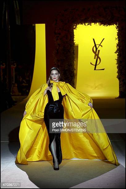 Model Carla Bruni walks the runway during the Yves Saint Laurent last show as part of Paris Fashion Week Haute Couture Spring/Summer 2002 on January...