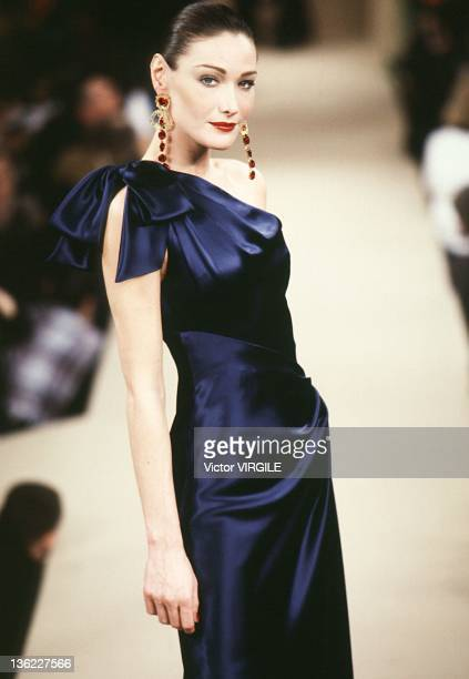 Model Carla Bruni walks the runway during the Yves Saint Laurent Haute Couture Spring/Summer show as part of the Paris Haute Couture week on January...