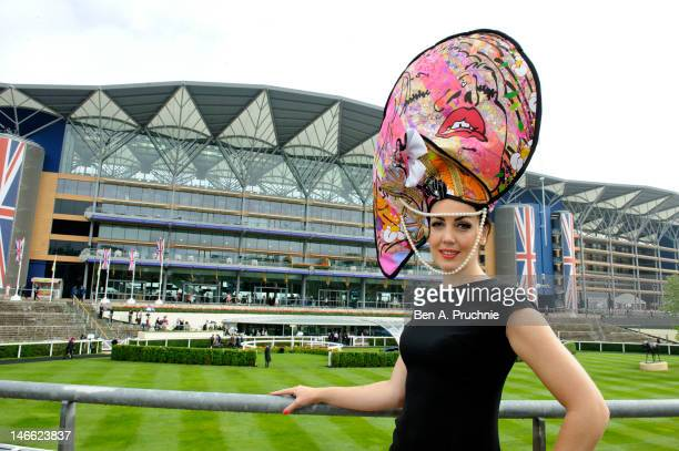 Model Carla Creegan wears a hat commissioned by Castle Galleries, inspired by the work of UK artist Louise Dear at Ladies Day Royal Ascot at Ascot...