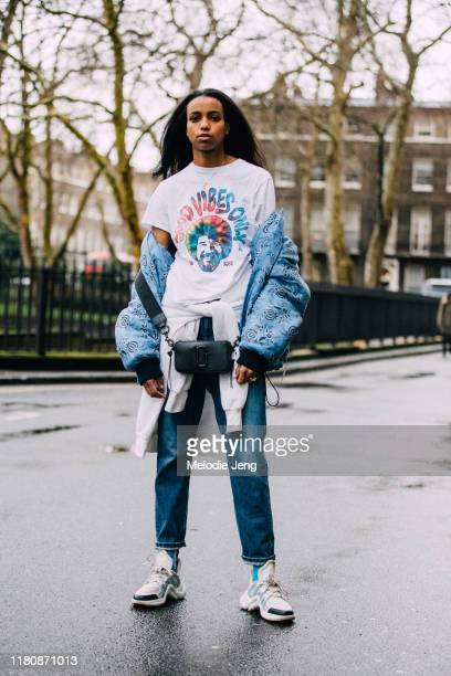 Model Carmen Amare wears a Bob Ross Good Vibes Only tshirt blue 31 Phillip Lim puffer jacket Phillip Lim bag jeans and white Louis Vuitton Archlight...