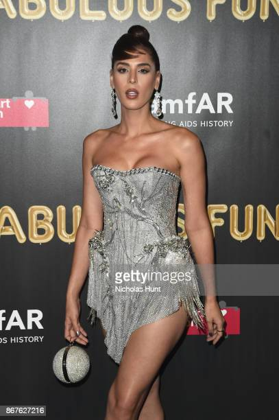 ce55366e494d Model Carmen Carrera attends the 2017 amfAR The Naked Heart Foundation  Fabulous Fund Fair at Skylight