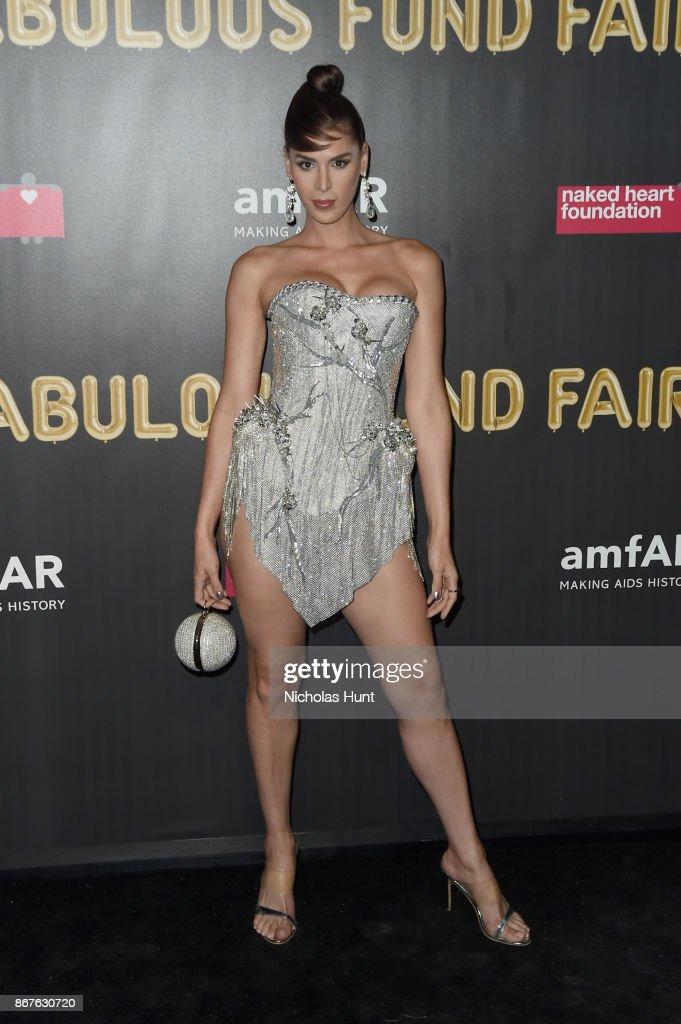 Model Carmen Carrera attends the 2017 amfAR & The Naked Heart Foundation Fabulous Fund Fair at Skylight Clarkson Sq on October 28, 2017 in New York City.