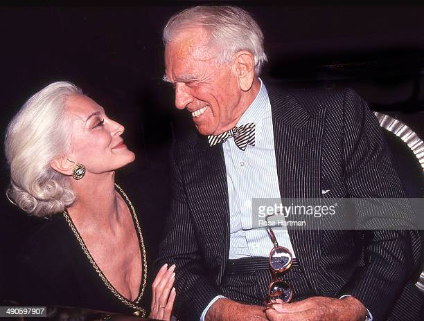 Model Carmen Dell'Orefice and the photographer Horst P Horst attend a book party for the latter held at Henri Bendel New York New York late 1980s