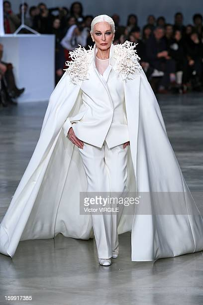 Model Carmen Dell'Orefice walks the runway during the Stephane Rolland Spring/Summer 2013 HauteCouture show as part of Paris Fashion Week at Palais...