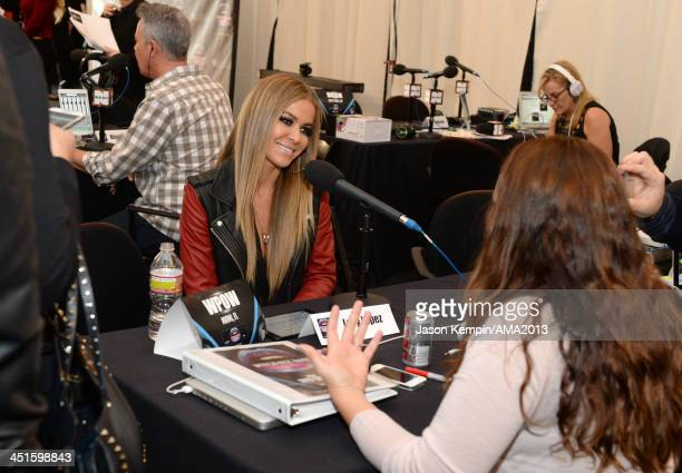 Model Carmen Electra attends day 2 of the 2013 American Music Awards gift lounge at Nokia Theatre LA Live on November 23 2013 in Los Angeles...
