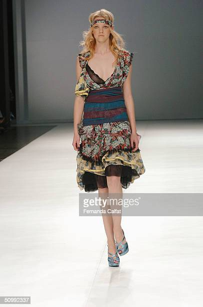 Model Carol Trentine walks the runway at the Patachou 2005 Spring/Summer collection during the Sao Paulo Fashion Week June 17 2004 in Sao Paulo Brazil