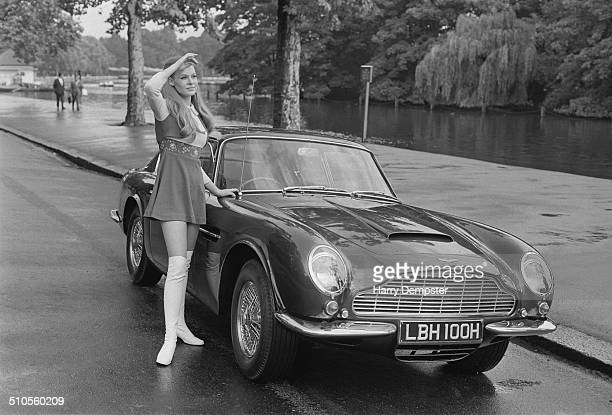 Model Carol Villiers shows off the new Aston Martin DB6 Mark II 1969