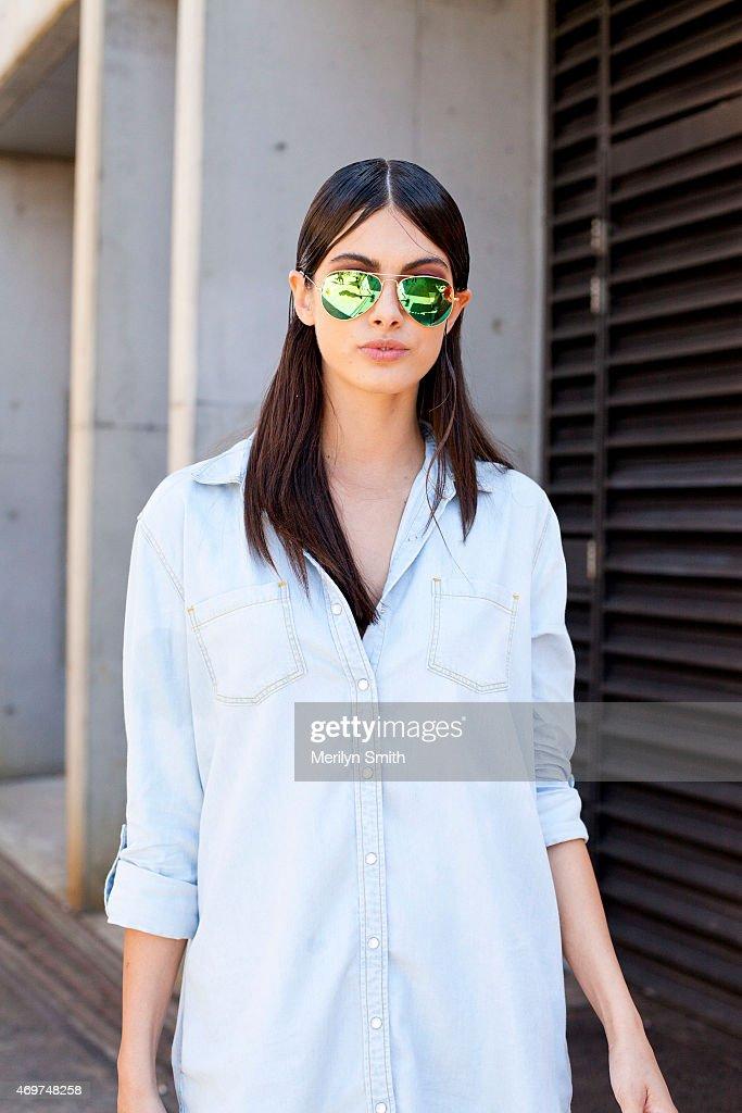 Model Caroline Austin wears a Sportsgirl shirt, and Rayban sunglasses at Mercedes-Benz Fashion Week Australia 2015 at Carriageworks on April 14, 2015 in Sydney, Australia.
