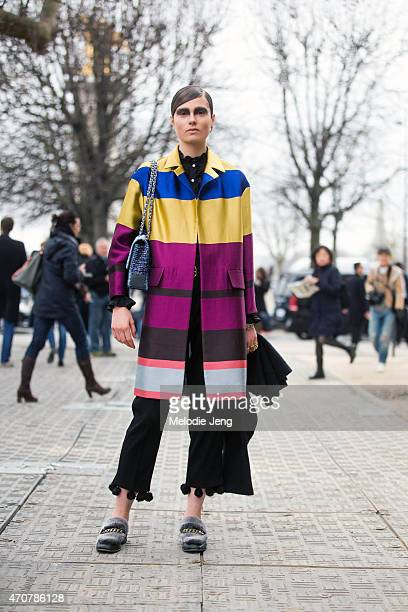 Model Caroline Brasch Nielsen exits the Chanel show at Grand Palais in a Dries Van Noten coat Chanel bag Boyy shoes hair by Sam McKnight and makeup...