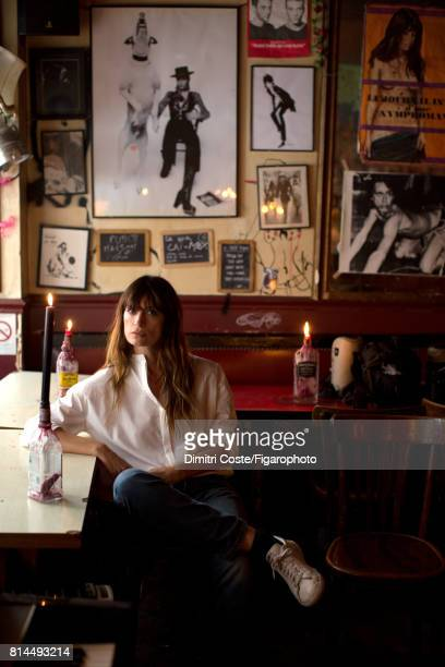 Model Caroline de Maigret is photographed for Madame Figaro on May 10 2017 at Le Fanfaron bar in Paris France Shirt Haider Ackermann jeans sneakers...