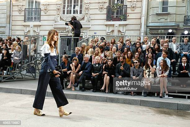 Model Caroline de Maigret walking the runway front of Anna Wintour Baz Luhrmann his wife Catherine Martin Astrid BergesFrisbey guest Xavier Dolan and...