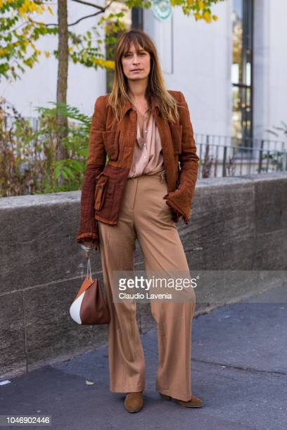 Model Caroline de Maigret wearing a tan jacket nude shirt beige trousers and tan bag is seen after the Haider Ackermann show on September 29 2018 in...