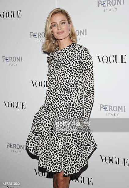 Model Carolyn Murphy attends The Visionary World of Vogue Italia Exhibition Opening Night presented by Peroni Nastro Azzurro at Industria Studios on...