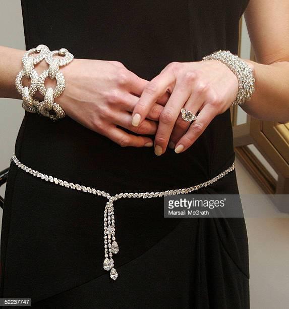 Model Carrie Niese presents two $168000 diamond bracelets a $900000 diamond ring a $1 million diamond cluster bracelet and a 129 carat diamond...