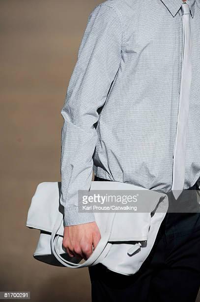 Model carries a bag walking the runway wearing the Marni Menswear Spring/Summer 2009 collection during Milan Fashion Week on June 24, 2008 in Milan,...