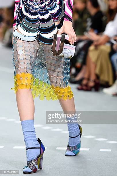 A model carries a clutch bag at the Mary Katrantzou show during London Fashion Week Spring/Summer collections 2017 on September 18 2016 in London...