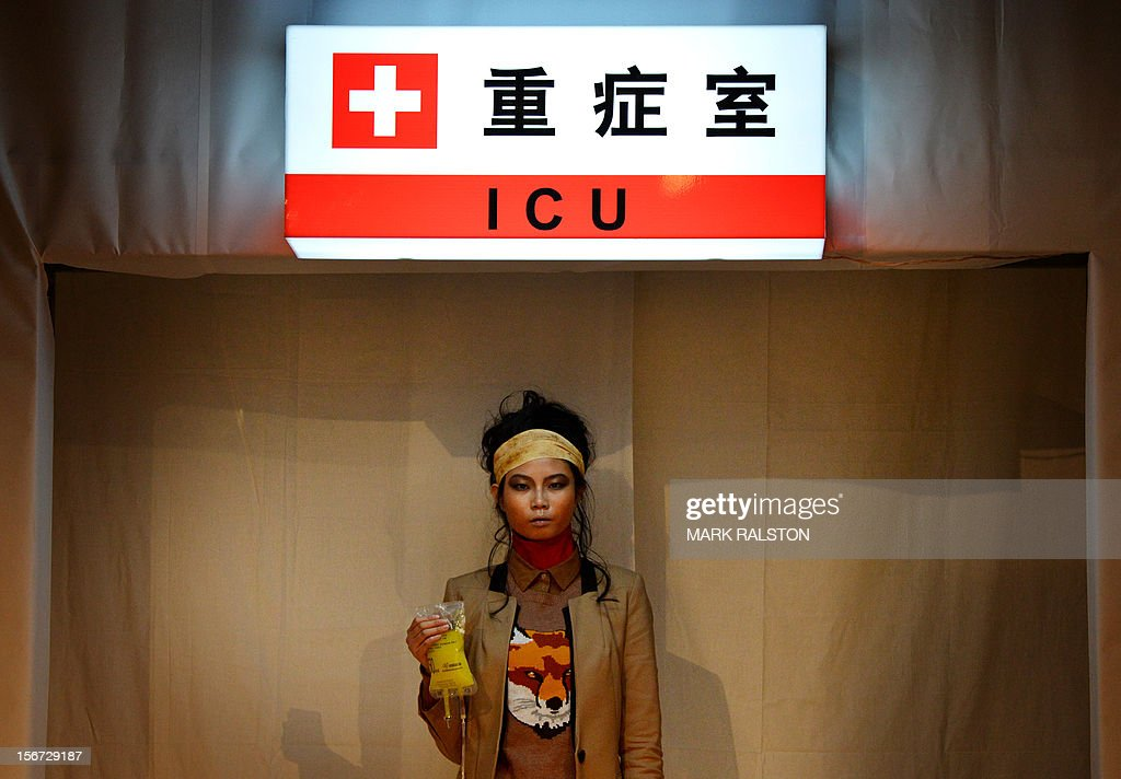 A model carries an IV bag during the 'Toxic Threads - The Big Fashion Stitch-up' fashion parade organized by environment action group Greenpeace to highlight chemical contamination in the fashion industry, in Beijing on November 20, 2012. Greenpeace released the results of a months-long global investigation into some of the world's top-selling fast fashion houses, with sample products purchased from nearly 30 countries. According to Greenpeace, nearly two thirds of the clothing tested positive for hormone-disrupting and dyes that release cancer-causing substances. AFP PHOTO/Mark RALSTON