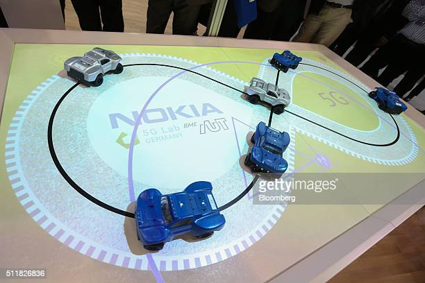 Model cars demonstrating 5G capabilities navigate around a track on the Nokia stand at the Mobile World Congress in Barcelona Spain on Tuesday Feb 23...