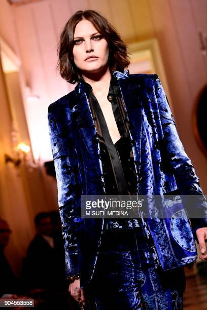 Model Catherine McNeil presents a creation for fashion house Versace during the Men's Fall/Winter 2019 fashion shows in Milan on January 13 2018 /...