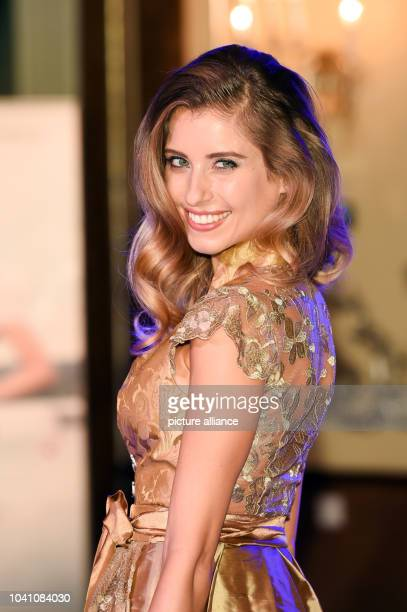 Model Cathy Hummels presents a Dirdl from the current Wiesn collection of a fashion house in Munich Germany 19 July 2016 Photo Tobias Hase/dpa |...