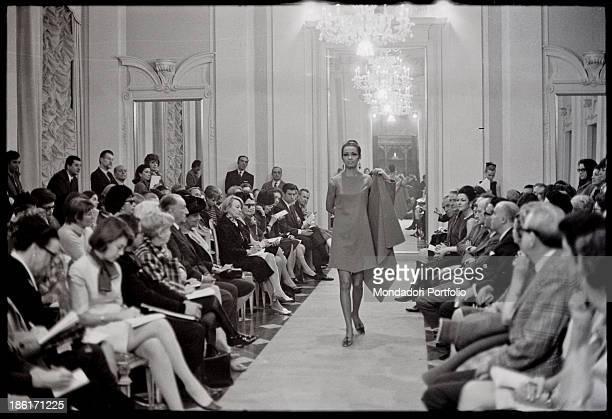 A model catwalking at Palazzo Pitti Florence 1960s