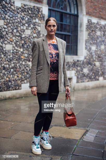 Model Cecilia Chancellor wears a dark gray tweed blazer, tie-dye skull t-shirt, black leggings, and high-top sneakers after the Preen by Thornton...