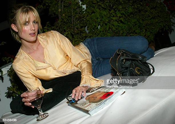 Model Celesta Hodge relaxes at GQ magazine's The Roof Is On Fire party at the Museum of Television and Radio August 23 2005 in Beverly Hills...