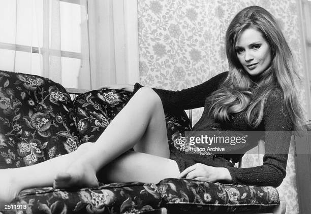 Model Celia Hammond relaxes in a knitted mini dress and chain belt 30th October 1968
