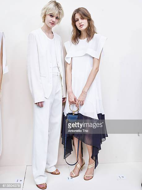 Model Celine Bouly and Louise Lefebure poses prior the Chloe show as part of the Paris Fashion Week Womenswear Spring/Summer 2017 on September 29...