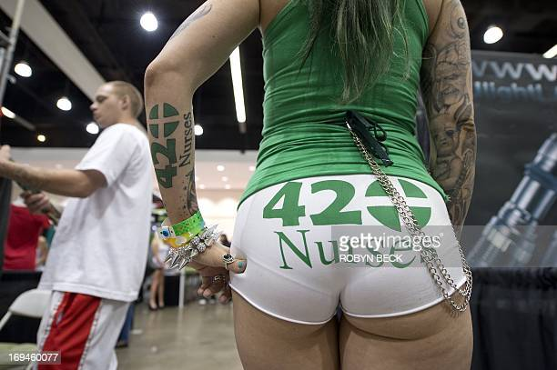 Model ChaCha VaVoom shows her style at the HempCon medical marijuana show May 24 2013 at the Los Angeles Convention Center Thousands of marijuana...