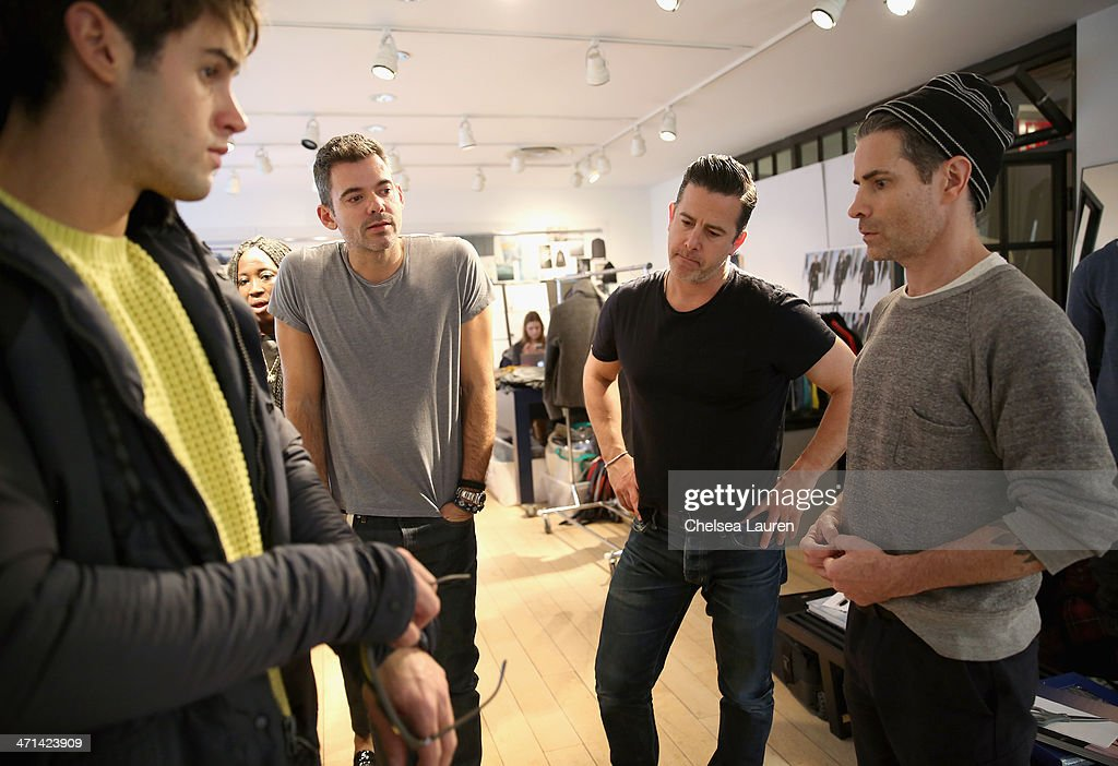 Model Chad White (left) and Vice President Design & Creative of Nautica Chris Cox (2nd from right) attend a fitting prior to a show for Black Sail by Nautica at Natuica Studio on January 31, 2014 in New York City.