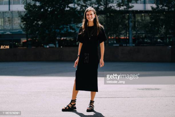 Model Chai Maximus wears a black dress, black iPhone on a chain necklace, and black sandals after the Ports 1961 show during London Fashion Week...