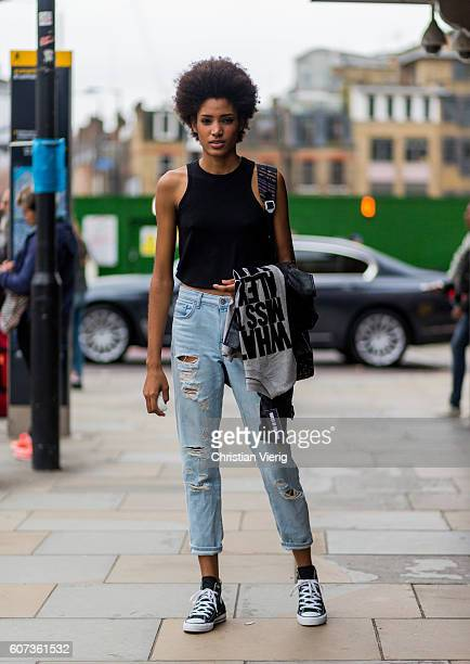 Model Chanel de Leon wearing Converse sneaker and ripped denim jeans outside of House of Holland during London Fashion Week Spring/Summer collections...