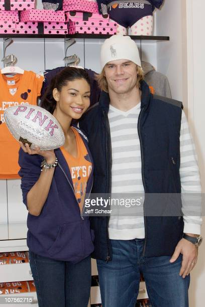 Model Chanel Iman and Chicago Bears football player Greg Olsen celebrate the VS PINK National Football League Collection at VS PINK Woodfield Mall on...