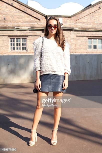 Model Chanel Stewart wears a Vanishing Elephant skirt vintage top Nude shoes Status Anxiety bag and AM Eyewear sunglasses at MercedesBenz Fashion...