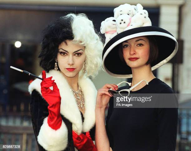 Model Chantelle wearing the Dolce Gabbana Haute Couture Dalmation dress and coat with Amie who sports a Stephen Jones felt cloche with white satin...