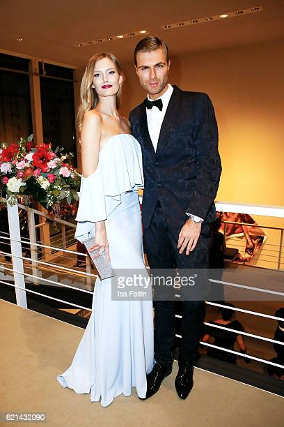 Model Charlott Cordes and fashion designer Andre Borchers arrive at the 23rd Opera Gala at Deutsche Oper Berlin on November 5 2016 in Berlin Germany