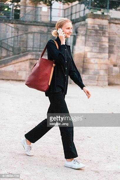 Model Charlotte Lindvig carries a Celine bag after the Jacquemus show at the Tuileries on September 27 2016 in Paris France