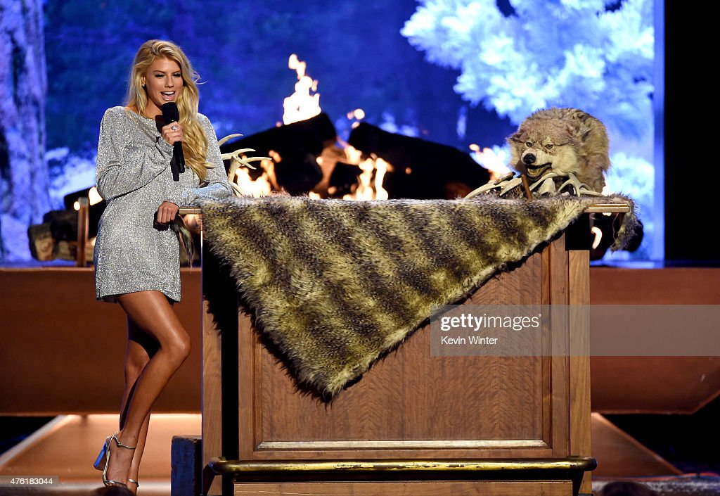 Model Charlotte McKinney (L) and Triumph, the Insult Comic Dog speak onstage during Spike TV's Guys Choice 2015 at Sony Pictures Studios on June 6, 2015 in Culver City, California.
