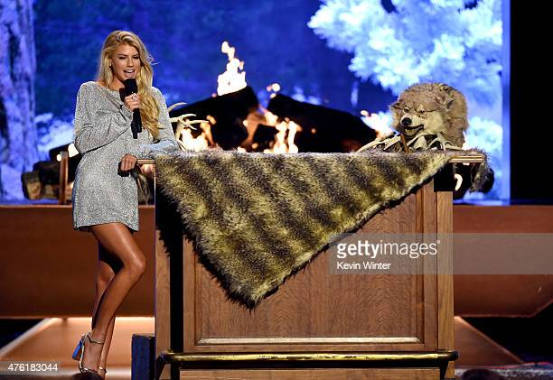 Model Charlotte McKinney and Triumph the Insult Comic Dog speak onstage during Spike TV's Guys Choice 2015 at Sony Pictures Studios on June 6 2015 in...