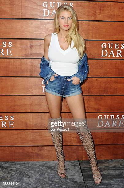 Model Charlotte McKinney arrives at GUESS Dare Double Dare Fragrance Launch at Ysabel on July 27 2016 in West Hollywood California